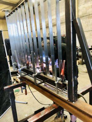Neil Hart, Tig welding the flats for the stainless-steel balustrading.